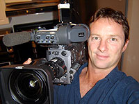 Peter Williams headshot with camera
